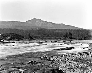 Cascades Rapids - Cascades Rapids. Greenleaf Peak and Red Bluffs are visible in the background.