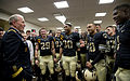 Chairman of the Joint Chiefs of Staff Gen. Martin E. Dempsey, left, speaks with West Point football players in the locker room after their win over Air Force in West Point, N.Y., on Nov 121103-F-IE715-1875.jpg