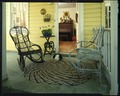Chairs and rabbit on porch LCCN2015645999.tif