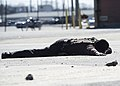 Charles Streat lays on the ground after being disarmed by U.S. Navy police Feb. 27, 2014, during a vehicle-borne improvised explosive device response exercise as part of Solid Curtain-Citadel Shield (SC-CS) 2014 140227-N-XQ474-051.jpg