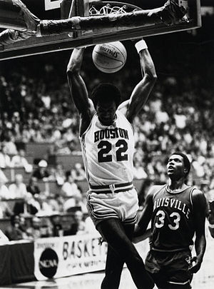 Houston Cougars men's basketball - Clyde Drexler performs a slam dunk as a member of the Houston Cougars men's basketball team under Lewis