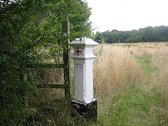 Farleigh, Surrey - Characteristic white coal-tax post by a public footpath in Fickleshole