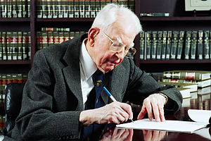 Ronald Coase - Ronald Coase working in 2003.  Photo taken at and by University of Chicago Law School.