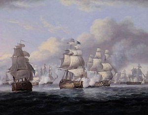 A naval battle. Three ships sail in the foreground, one billowing gunsmoke. Five more ships lie in the backgroumd. There is a rough sea and a sky with large clouds.