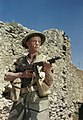 Corporal M Smith of the Duke of Cornwall's Light Infantry, posing with a Thompson sub-machine gun in the San Angelo area of Italy, April 1944. TR1711.jpg