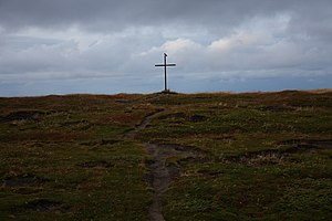A cross close to the church in Grense Jakobsel...