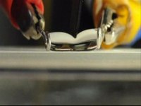 File:Cutting a water droplet using a superhydrophobic knife on superhydrophobic surfaces.ogv