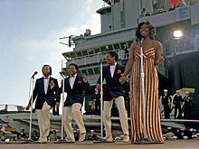 "Gladys Knight & The Pips perform aboard the aircraft carrier USS Ranger on November 1, 1981. Left to right: William Guest, Edward Patten, Merald ""Bubba"" Knight, and Gladys Knight."