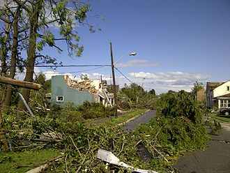 Goderich, Ontario - Felled trees and demolished buildings along a road in Goderich after the tornado.
