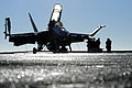 Defense.gov News Photo 101102-N-9132C-132 - U.S. Navy sailors assigned to Strike Fighter Squadron 154 prepare a Navy F A-18F Super Hornet aircraft for the first launch cycle of the day aboard.jpg