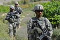Defense.gov News Photo 110614-F-BP133-009 - U.S. Army Spc. Daishon Newton assigned to the Zabul Provincial Reconstruction Team security force provides security as members of the team make.jpg