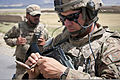 Defense.gov News Photo 120606-A-ZU930-027 - U.S. Air Force Tech. Sgt. Dale Spencer inspects an old round of ammunition that was found near a cave on a mountainside near Bagram Airfield Parwan.jpg