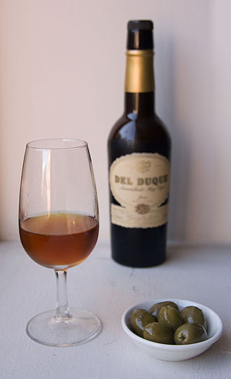 Sherry - A glass of Amontillado Sherry with olives