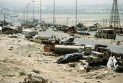 Demolished vehicles line Highway 80 on 18 Apr 1991
