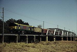 Central Western railway line, Queensland - QR electric loco 3903 hauling a special train crosses the Nogoa River bridge, east of Emerald, September 1989