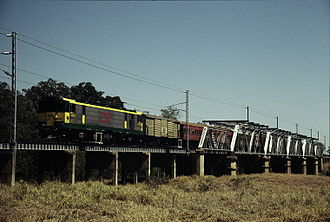 Central Western railway line, Queensland - QR electric loco 3903 hauling a special train crosses the Nogoa River bridge, east of Emerald, September 1989