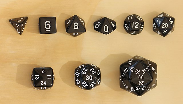 A nine dice kit, consisting of a regular tetrahedron, a cube, a regular octahedron, a pentagonal trapezohedron, a regular dodecahedron, a regular icosahedron, a tetrakis cube, a rhombic triacontahedron and a triakis icosahedron