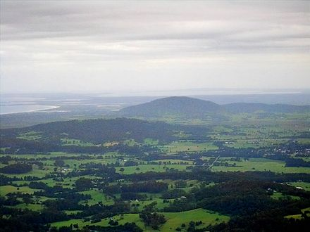 A large part of Shoalhaven can be seen from the Drawing Room Rocks area in Barren Grounds Nature Reserve. Mount Coolangatta is in the centre, with Jervis Bay in background and Berry in the right front E9512-Coolangatta-Mt-NSW.jpg