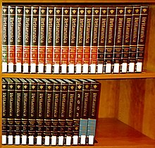 Colour photograph of the Encyclopaedia Britannica on two book shelves
