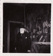 "James Sidney Edouard, Baron Ensor in front of ""Entry of Christ into Brussels"" in his house in Ostend, 1940s, photo by Albert Lilar"