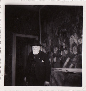 "James Ensor - Ensor in front of ""Entry of Christ into Brussels"" in his house in Ostend, 1940's, photo by Albert Lilar"