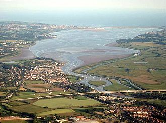 River Exe - The Exe Estuary from a balloon over Exeter. The M5 motorway is in the foreground, Topsham on the left bank just beyond, and Exmouth at the river mouth opposite Dawlish Warren.