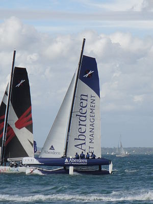 Aberdeen Asset Management - An Extreme 40 class sailing catamaran, seen racing off Egypt Point, Cowes, Isle of Wight