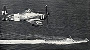 F8F-2P Bearcat of VC-62 in flight over USS Midway (CVB-41), in 1952