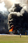 Firefighters work to put out the flames moments after a hijacked jetliner crashed into the Pentagon at approximately 0930 on September 11, 2001 010911-M-CI426-038.jpg