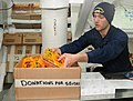 Flickr - Official U.S. Navy Imagery - Sailor places food in a box bound for Sendai, Japan..jpg