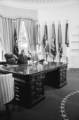 Wilson desk -  Gerald Ford sitting at the Wilson Desk before his redesign of the Oval Office decor