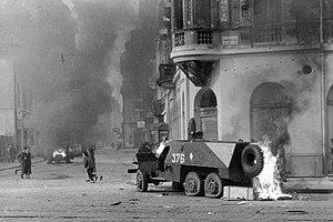 Fortepan 12830 Rákóczi út - Akácfa utca sarok. Kiégett szovjet BTR-152 páncélozott lövészszállító jármű..jpg