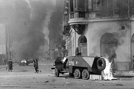 A Soviet built armored car burns on a street in Budapest in November Fortepan 12830 Rakoczi ut - Akacfa utca sarok. Kiegett szovjet BTR-152 pancelozott loveszszallito jarmu..jpg
