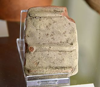 Hu, Egypt - Image: Fragment of pottery door granary, used as a lamp. Probably dates back to the 2nd intermediate period. Probably from Cemetery W at Diospolis Parva (Hu), Egypt. The Petrie Museum of Egyptian Archaeology, London