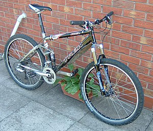 Bicycle suspension - A full suspension mountain bike, in this case, an older Trek Fuel with a linkage driven single pivot design.