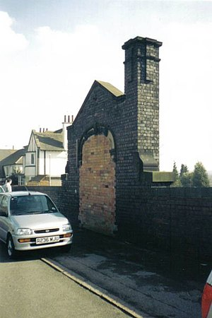 Belgrave and Birstall railway station - The bricked-up road-level entrance to Belgrave and Birstall station as seen in 2003