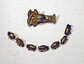 Germanic grave goods from Schwanbeck - fibula and beads.jpg