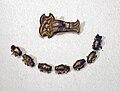 Germanic grave goods from Schwanbeck - fibula and beads.jpg