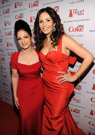 Giselle Blondet - Giselle Blondet (right) with Gloria Estefan at The Heart Truth fashion show in 2012