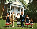 Governor LeRoy Collins and his family walking on the front lawn of the Grove.jpg