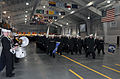 Graduating U.S. Navy recruits march in formation for the final pass in review before graduation in the USS Midway Ceremonial Drill Hall of Recruit Training Command aboard Naval Station Great Lakes, Ill., Dec 121228-N-IK959-866.jpg