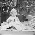 Granada Relocation Center, Amache, Colorado. Nine month old Takashi Yoshida symbolizes the spirit o . . . - NARA - 539414.tif