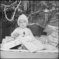 Granada Relocation Center, Amache, Colorado. Nine month old Takashi Yoshida symbolizes the spirit o . . . - NARA - 539414.tif