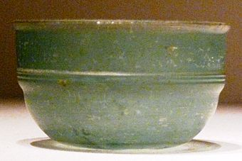 A green Roman glass cup unearthed from an Eastern Han Dynasty (25-220 AD) tomb in Guangxi, southern China; the earliest Roman glassware found in China was discovered in a Western Han tomb in Guangzhou, dated to the early 1st century BC, and ostensibly came via the maritime route through the South China Sea Green glass Roman cup unearthed at Eastern Han tomb, Guixian, China.jpg
