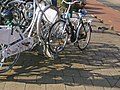 Group of city bikes in the streets of Amsterdam, spring 2013.jpg