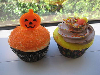 Halloween cupcakes with candy corn and pumpkin...