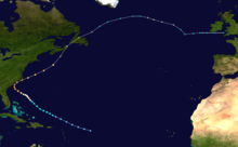 Path of a tropical cyclone on a map, with colored dots representing the storm's position and intensity in six-hour intervals. The track begins and bottom-center, moves towards left-center, and then moves back right to the upper-right corner.