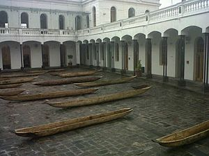 Ecuador - Antique dug out canoes in the courtyard of the Old Military Hospital in the Historic Center of Quito