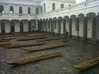 Indigenous peoples in Ecuador - Photographed in the Historic Center of Quito at the Old Military Hospital are these antique dug out canoes in the courtyard