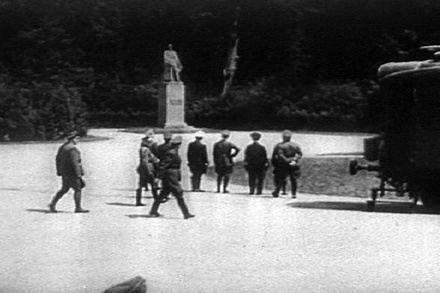 On 21 June 1940, near Compiegne in France, Hitler (hand on hip) staring at Marshal Foch's statue before starting the negotiations for the armistice, to be signed the next day by Keitel, Hitler being absent. The Glade of the Armistice was soon destroyed together with all commemorative monuments (except Foch's statue) by the Germans. Hitler and german-nazi officers staring at french marechal foch statue 21 June 1940.png